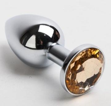 Серебристая анальная пробка с желтым кристаллом - 8,2 см.