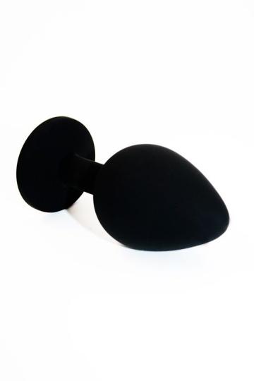 Чёрная силиконовая анальная пробка с чёрным кристаллом - 7 см.